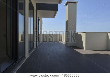 View of a Penthouse Apartment Terrace and Blue Sky
