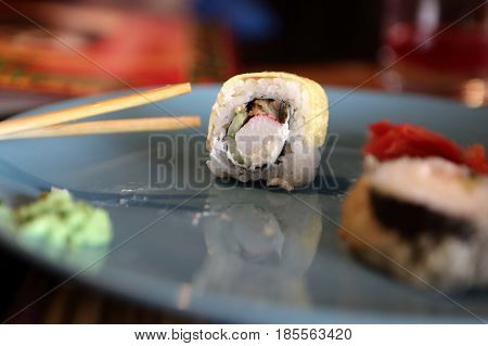 Sushi on blue plate in a cafe