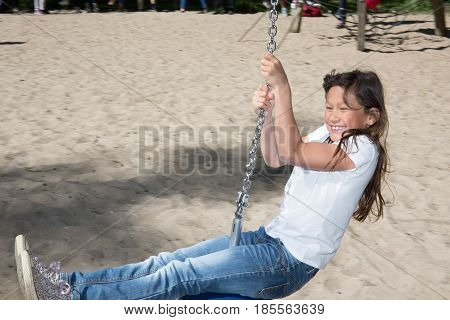 Cheerful Young Girl Make Zip Line In The Park For Children