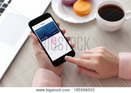 Women hands holding phone with debit card and app touch pay
