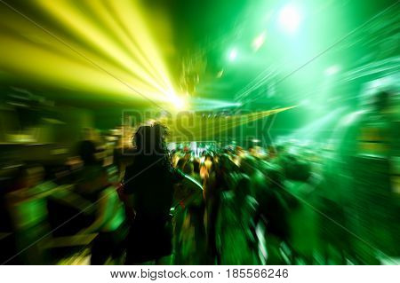 Young people dancing in night disco club with color laser lights in background - Concept of nightlife with music entertaiment - Focus on black afro hair woman head - Radial defocused editing
