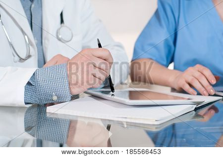 Doctors Having A Meeting In Medical Office