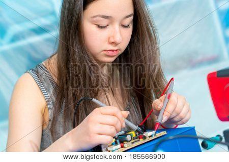 Student girl in robotics lab
