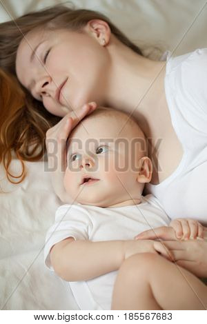 Mom and baby. Mother with daughter or son. Tenderness and embrace, happiness maternity, home comfort and warmth.