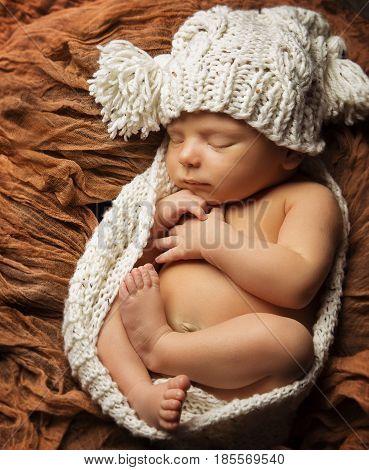 Newborn Baby Sleep New Born Kid Sleeping in Hat One Month Child Asleep over Brown Background