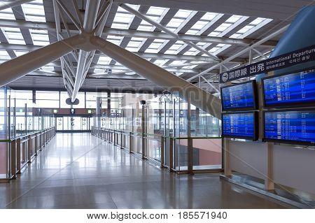 Osaka, Japan - April 2016: International Departure Flight Schedule Information Board Inside Passenge