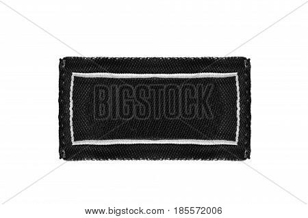 Blank black clothes label isolated over white
