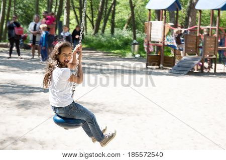Young Girl Make Zip Line In The Park For Children