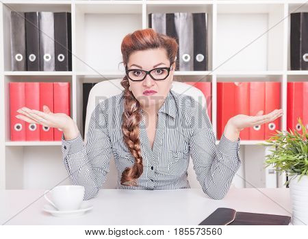 Business Woman Shrugging Her Shoulders In Office