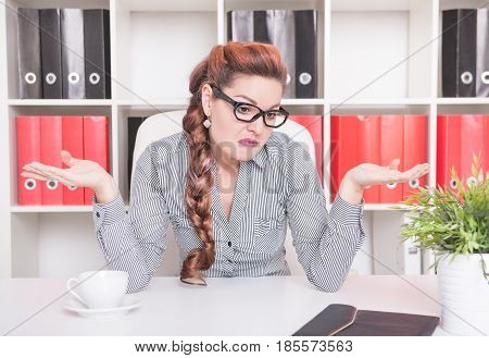 Business Woman Shrugging Her Shoulders