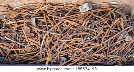 Old rusty iron nails of different sizes
