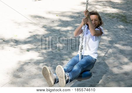 cheerful girl make zip line in the park for child