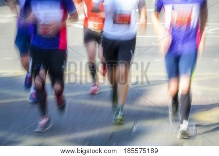 Blurred motion of group of marathon runners