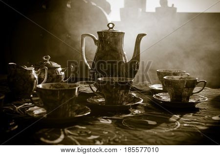 Food Background Tea And Coffee Theme. Old Vintage Ceramic Tea Or Coffee Pot With Cups Jug And Sugar