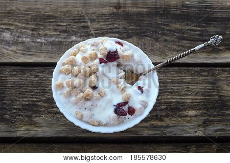 Wheat dry balls with yoghurt and dry berries cranberries