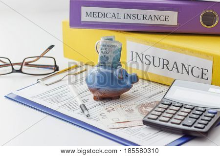 Clean Insurance Form, Folders, Pen, Piggy Bank, Calculator And Glasses