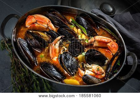 Seafood. Crabs with mussel in metal pot. Mariscal or paila marina. Seafood shellfish soup with musssels and crabs