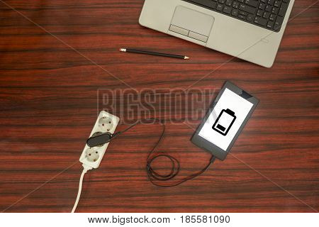 Tablet Connected To A Power Outlet.