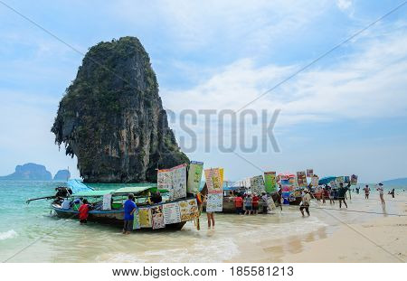 KRABI THAILAND - APRIL 12 2016 : Long-Tailed boats Food and drink vendor at Railay beach with high limestone cliffs in Krabi province, Thailand.