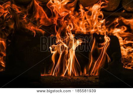 A big red flames in a fire place