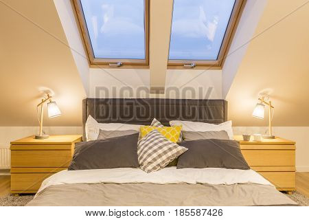 King-size bed in modern bedroom in the attic