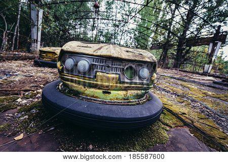 Fun fair bumper car in abandoned Pripyat city of Chernobyl Exclusion Zone Ukraine