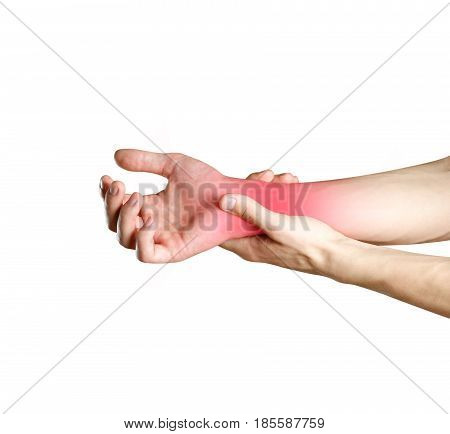 A Man Hands Holds By The Wrist. The Pain In My Arm. Sore Point Highlighted In Red. Closeup. Isolated