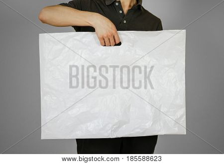 The Guy Is Holding A Plastic Bag. Closeup. Isolated