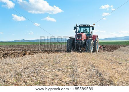 agricultural machinery working the land in the field