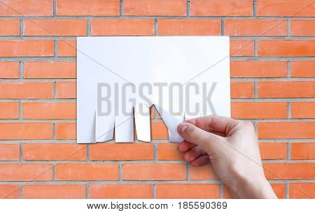 Hand Pulls A Piece Of Paper. Empty Paper Ad Loose Leaves Isolated On A Grey Background. Attached Met