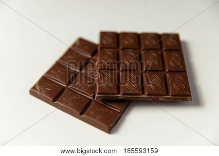 Chocolate Pieces On A White Background