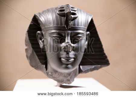 BERLIN GERMANY - APRIL 7: Head of a statue of king Amasys in Egyptian museum on April 7 2017 in Berlin