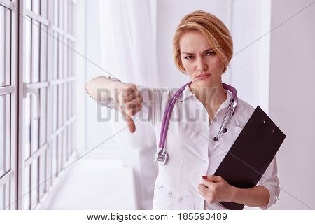 Closeup Portrait, Doctor Woman, Giving Thumbs Down Gesture