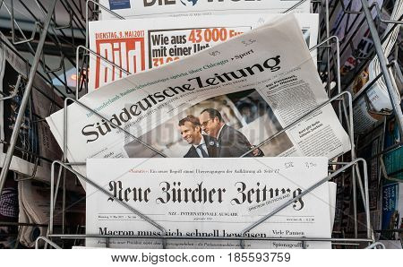 PARIS FRANCE - MAY 9 2017: Sueddeutsche Zeitung newspaper front page with the picture of the newly elected French president Emmanuel Macron and Francois Hollande after the second round French Presidential election