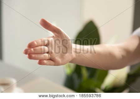 Close up image of reached out for handshake womans hand. Welcome at negotiations or meeting, congratulations with successful deal or contract, gesture of collaboration, partnership relations concept