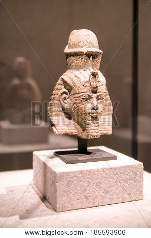 BERLIN GERMANY - APRIL 7: Head of a statue of Amenhotep III in Egyptian museum on April 7 2017 in Berlin