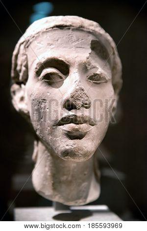 BERLIN GERMANY - APRIL 7: Head of a statue of pharaoh Akhenaten (Amenhotep IV) in Egyptian museum on April 7 2017 in Berlin