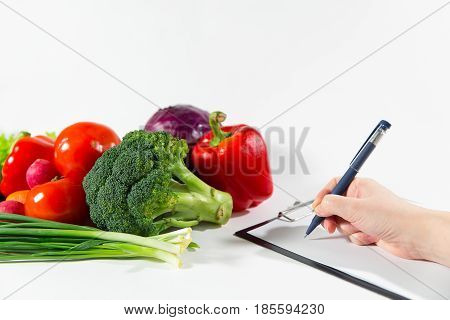 Nutritionist Doctor Writing Vegetable Diet Plan