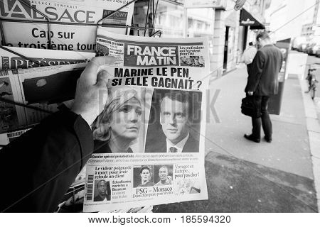 PARIS FRANCE - MAY 9 2017: Pov buying France Matin newspaper front page with the picture of the newly elected French president Emmanuel Macron and le Pen after the second round French Presidential election