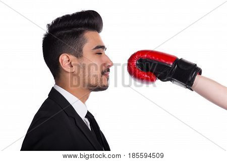 Business Conflict Concept. Young Man In Suit Gets Hit From Boxer In Boxing Gloves