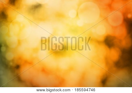 Abstract background in luminous autumn colors with bokeh