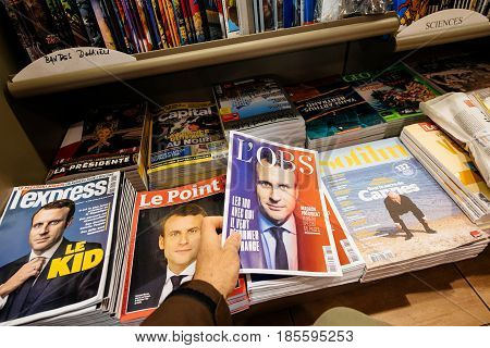 PARIS FRANCE - MAY 9 2017: Pov buying magazines L'OBS and Le Point with front page of the newly elected French president Emmanuel Macron second round French Presidential election