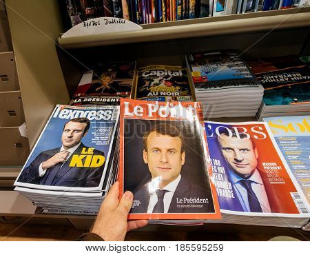 PARIS FRANCE - MAY 9 2017: Pov buying magazines LÉxpress and Le Point with front page of the newly elected French president Emmanuel Macron second round French Presidential election