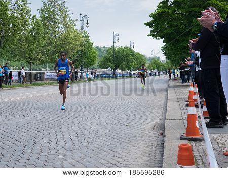 Prague, Czech Republic - May 7, 2017: Volkswagen Prague Marathon 2017 winner ABRAHA GEBRETSADIK finishes 42,195km distance in Prague, Czech Republic