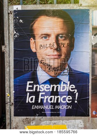 PARIS FRANCE - MAY 9 2017: Emmanuel Macron portrait poster detail next to polling place after the second round French presidential election marker inscription Member of Bilderberg group