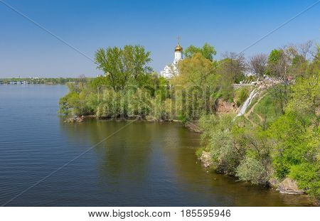 Spring landscape with an Orthodox church on a Monastyrsky island on Dnipro river Dnipro city Ukraine.