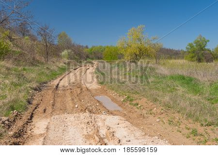 Seasonal landscape with clay dirty road in Ukraine