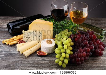 Cheese Platter With Different Cheese And Grapes And Red Wine