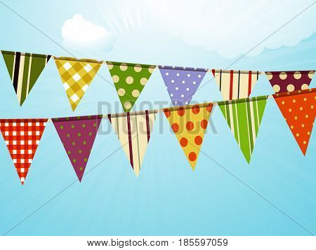 Colourful Vintage Bunting Over Blue Sunny Sky with Clouds