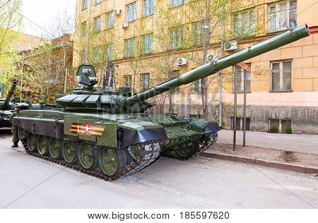 Samara Russia - May 6 2017: New military modified russian army main battle tank T-72B3M in green camouflage at the city street in Samara Russia